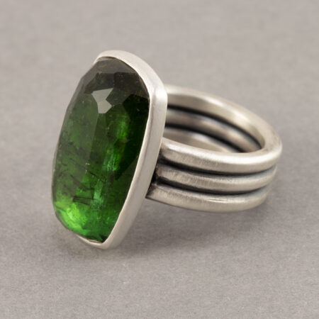 Green tourmaline ring in oxidised sterling silver