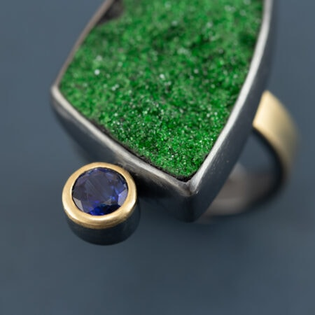 Detail of Uvarovite and kyanite ring in recycled sterling silver and 18ct gold