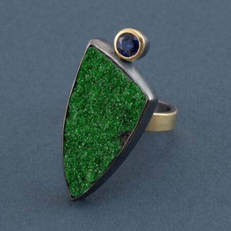 Uvarovite and kyanite ring in recycled sterling silver and 18ct gold on dark blue background
