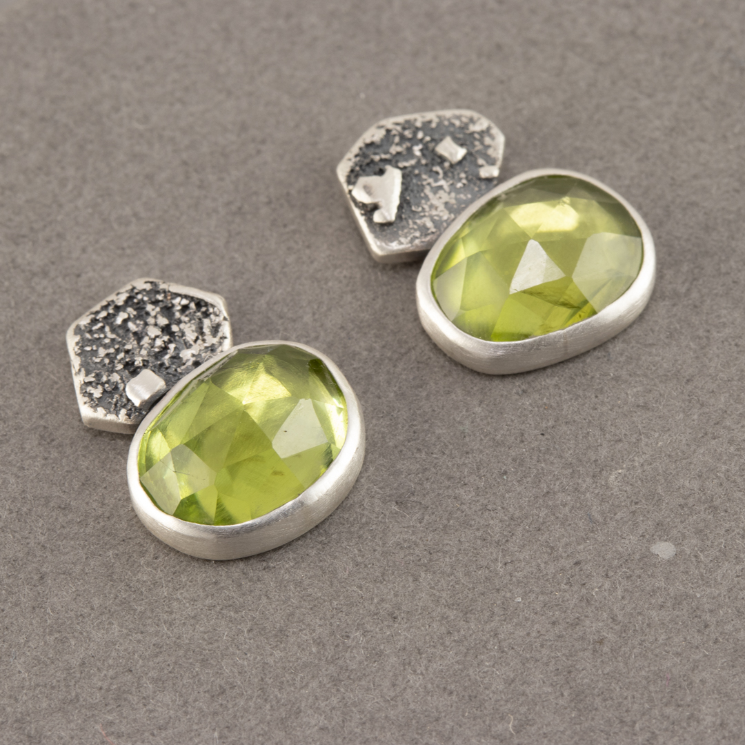 Peridot stud earrings in textured sterling silver
