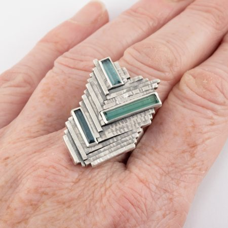 Tourmaline and sterling silver ring on hand