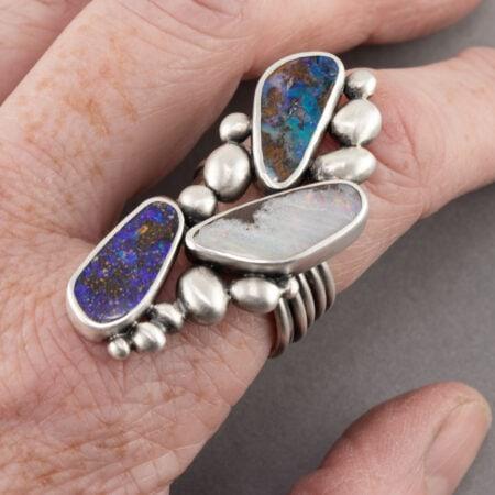 Boulder opal ring worn on hand