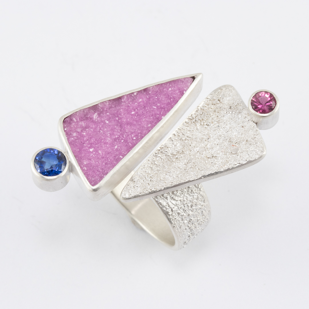 Side view of cobalt calcite ring in textured sterling silver with tourmaline and kyanite
