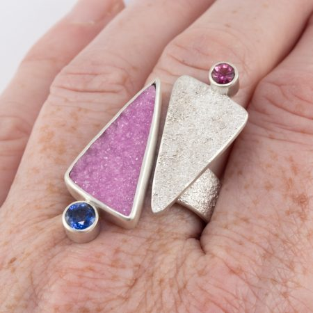 Cobalt calcite ring in textured sterling silver with tourmaline and kyanite worn on finger