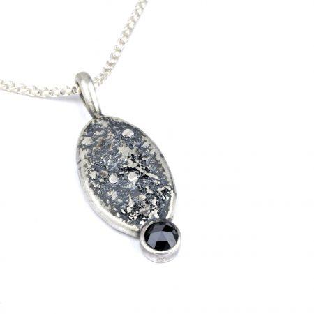 Black diamond pendant on white background