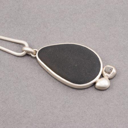Beach pebble and raw diamond pendant