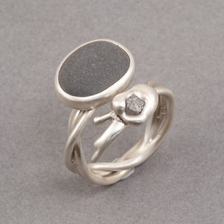 Beach pebble and grey raw diamond on an open twisted silver ring band