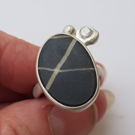 Beach pebble ring with white diamond slice in recycled brushed silver silver