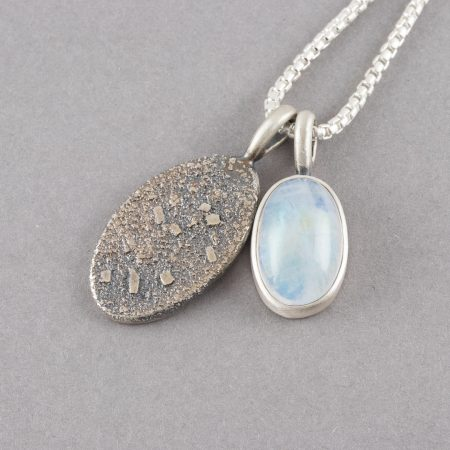 Silver and rainbow moonstone pendants