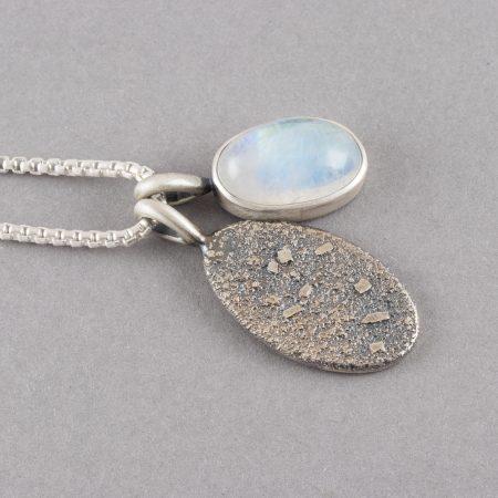 Handmade rainbow moonstone pendants in sterling silver