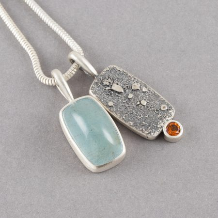 Aquamarine and orange topaz duo pendants in textured sterling silver
