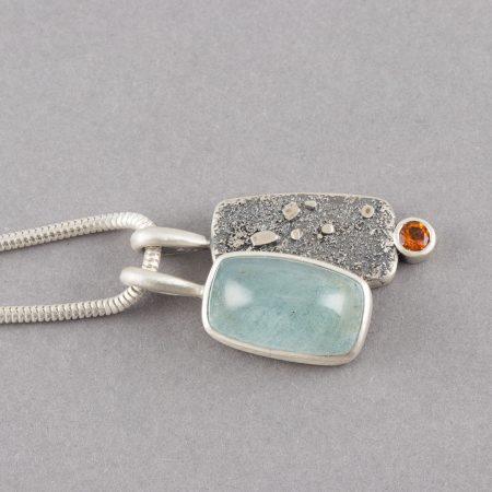 Handmade aquamarine and topaz pendants