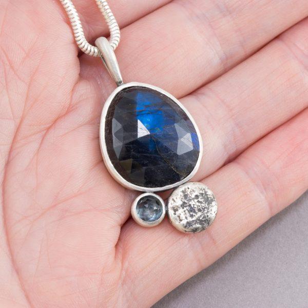 Labradorite and aquamarine pendant in hand