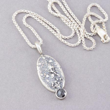 Black diamond pendant on rounded box chain