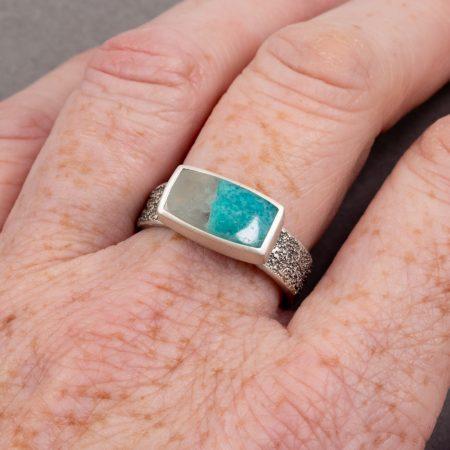Amazonite ring worn on hand