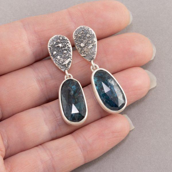 Kyanite stud earrings in hand
